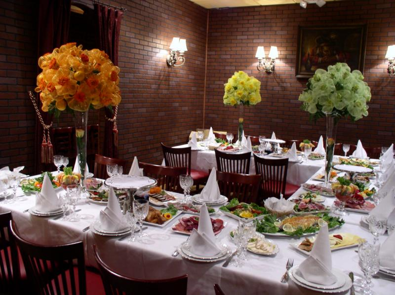 Beautifuly decorated tables with delicious cold and hot appetizers,